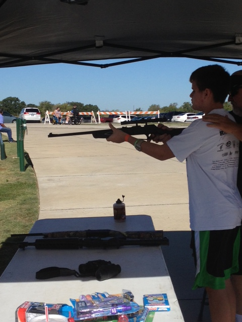 Me shooting an airsoft rifle at a target
